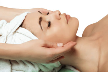 beautiful and young girl doing anti-aging facial massage